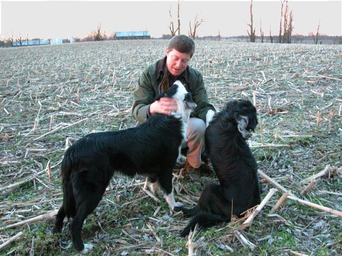 Kneeling w dogs sky fixed
