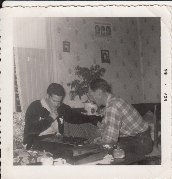 1956-dad-and-papaw-owens-playing-checkers